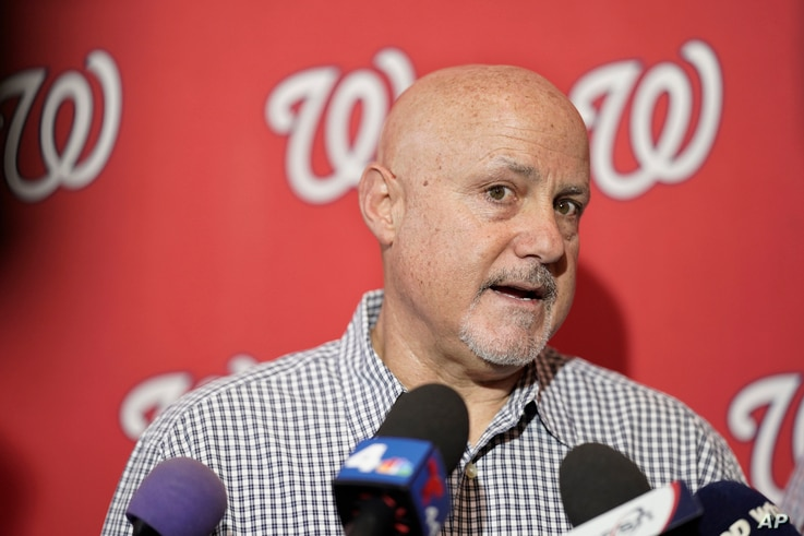 FILE - In this Jan. 11, 2020, file photo, Washington Nationals general manager Mike Rizzo talks with members of the media…