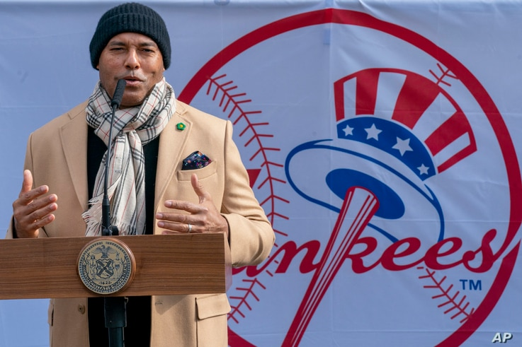 Hall of Fame inductee New York Yankees former pitcher Mariano Rivera speaks to reporters at a COVID-19 vaccination site at…