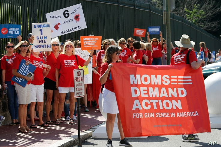 FILE - In this July 9, 2019 file photo, Moms Demanding Action  rally at the State Capitol in Richmond, Va.