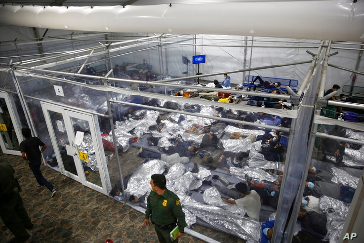 Young minors lie inside a pod at the Donna Department of Homeland Security holding facility, the main detention center for…