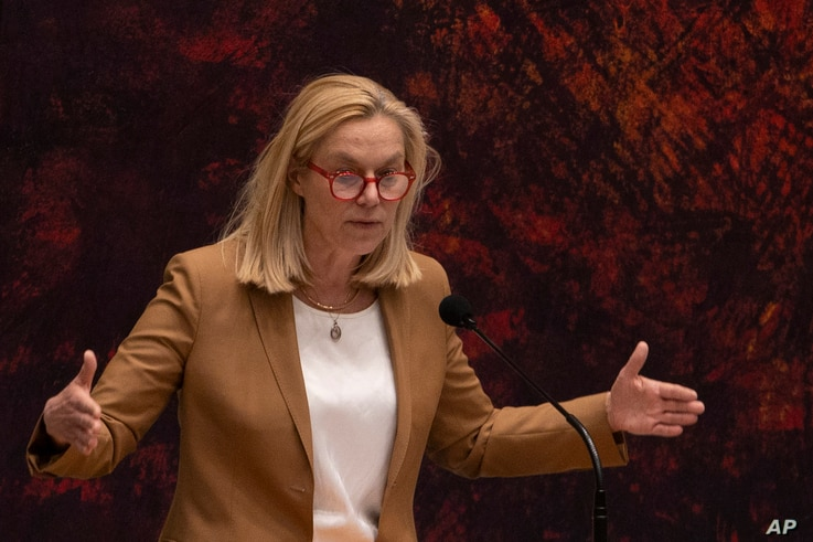 Sigrid Kaag, leader of the centrist D66 party that finished second in elections last month, right, gestures during a debate in…