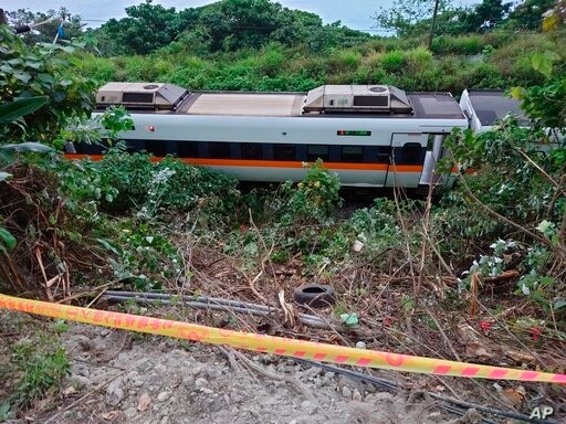 A section of a derailed train is seen cordoned off near the Taroko Gorge area in Hualien, Taiwan on Friday, April 2, 2021. The…