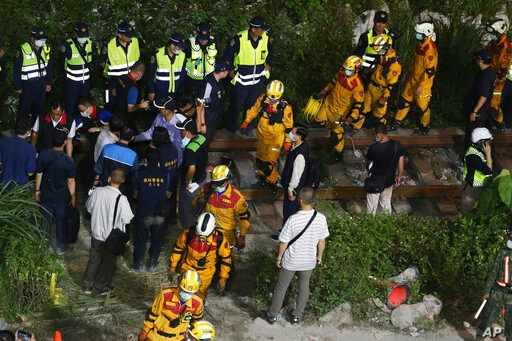 A team of rescue workers change shift at the derailed train near the Taroko Gorge area in Hualien, Taiwan on Friday, April 2,…