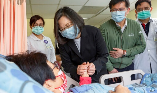 In this photo released by the Taiwan Presidential Office, Taiwan President Tsai Ing-wen visits those injured in Friday's train...