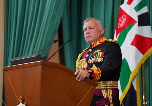 FILE - In this Dec. 10, 2020  photo released by the Royal Hashemite Court, Jordan's King Abdullah II gives a speech during the…