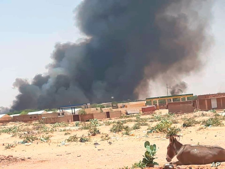 This photo provided by Organization for the General Coordination of Camps for Displaced and Refugees, smoke rises from Abu Zar camp for displaced persons in West Darfur, Sudan, April 6, 2021.