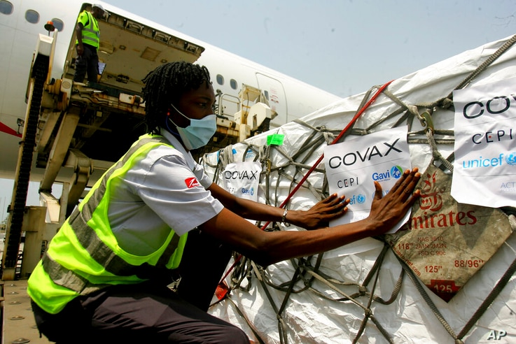FILE - In this Feb. 25, 2021, file photo, a shipment of COVID-19 vaccines distributed by the COVAX global initiative arrives in…