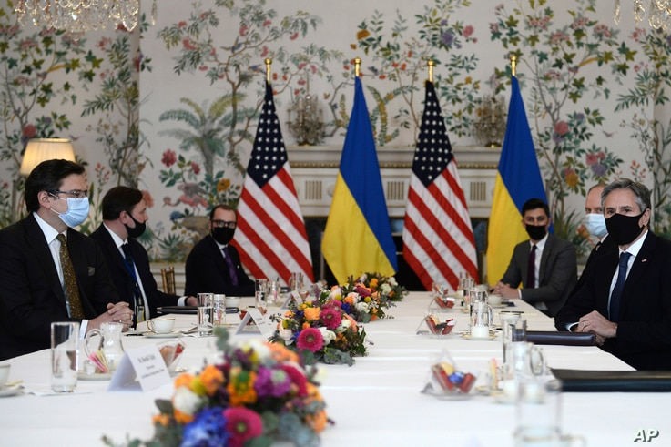 Ukrainian Foreign Minister Dmytro Kuleba, left, meets with United States Secretary of State Antony Blinken, right, in Brussels,…
