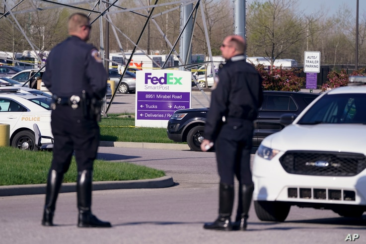 Police stand near the scene where multiple people were shot at the FedEx Ground facility early Friday morning, April 16, 2021.