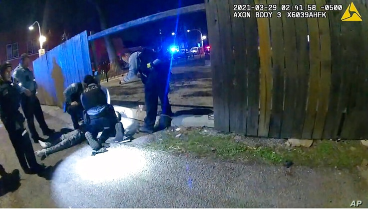 This March 29, 2021, photo from Chicago Police body cam video photo shows Chicago Police performing CPR on 13-year-old Adam…