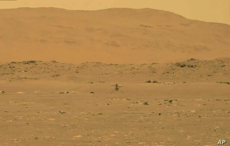 In this image from NASA, NASA's experimental Mars helicopter Ingenuity lands on the surface of Mars Monday, April 19, 2021.