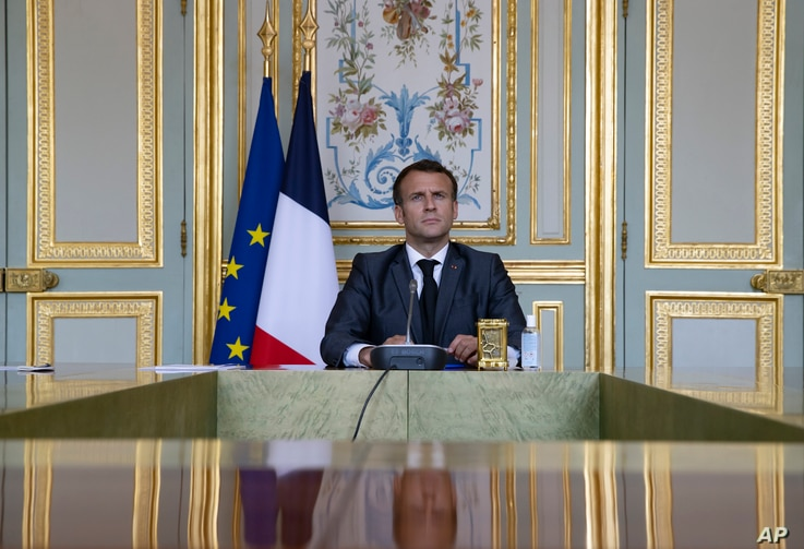French President Emmanuel Macron attends a Climate Summit video conference, at the Elysee Palace, in Paris, France.