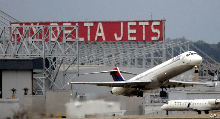FILE - In this April 14, 2008 file photo, a Delta Airlines jet departs Hartsfield Jackson Atlanta International Airport in…