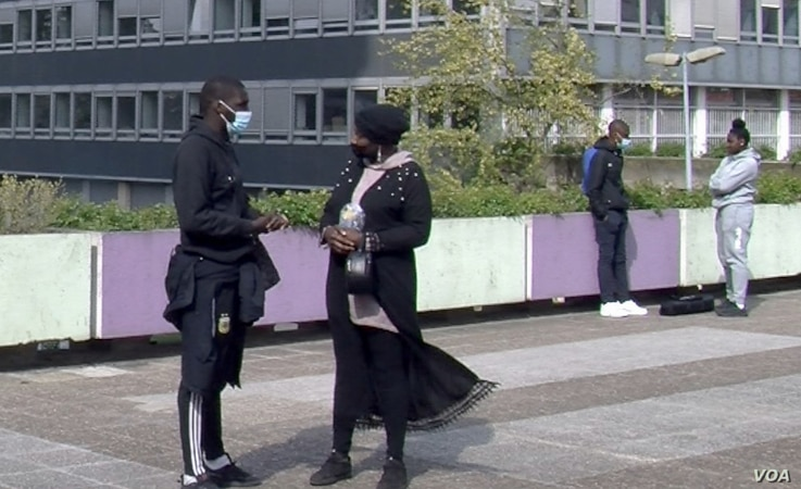 Aboubacar N'diaye, left, helped launch a youth group in the Paris suburb of Bobigny. He says police profiling is something that could happen to him. (Lisa Bryant/VOA)