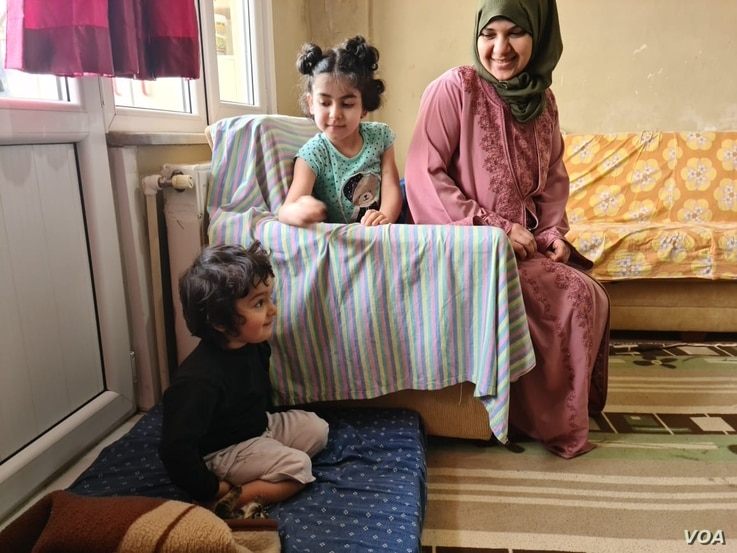 Marwa al-Awas, Mohammed's wife, fears travel to Europe but sees no other way to educate her children, April 17, 2021. (VOA/H.Murdock)