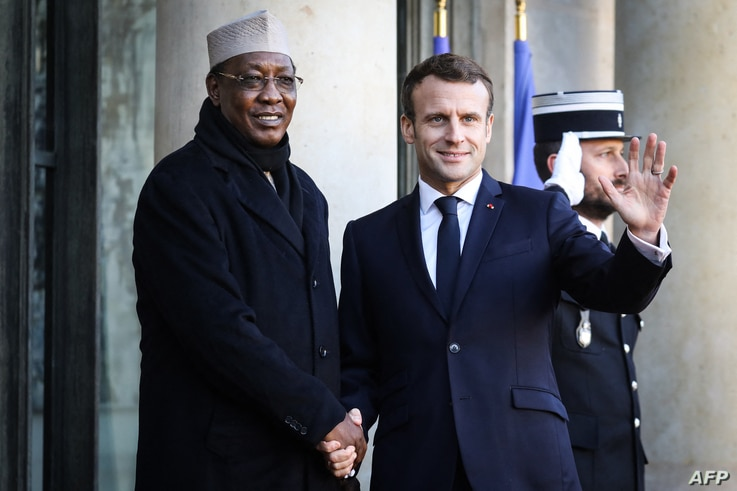 FILE - France's President Emmanuel Macron (R) welcomes Chad's President Idriss Deby at the Elysee presidential palace for a lunch as part of the Paris Peace Forum, Nov. 12, 2019.