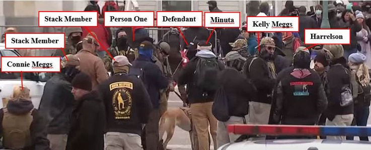 Federal prosecutors say this photo shows members of the far-right Oath Keepers militia group standing near their leader, Stewart Rhodes, outside the Capitol for what prosecutors describe as