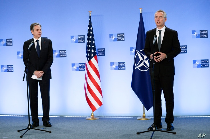 NATO Secretary General Jens Stoltenberg, right, and United States Secretary of State Antony Blinken address the media at NATO headquarters in Brussels, Belgium, April 14, 2021.
