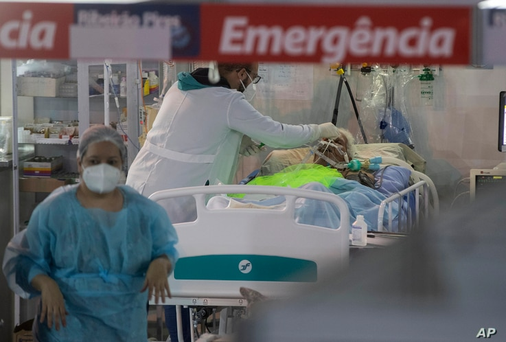 Health workers treat a COVID-19 patient at the emergency unit of a field hospital set up to treat COVID patients in Ribeirao Pires, greater Sao Paulo area, Brazil, April 13, 2021.