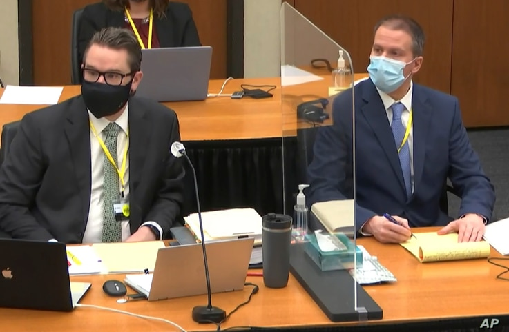 In this image from video, defense attorney Eric Nelson, left, and defendant former Minneapolis police Officer Derek Chauvin, April 5, 2021