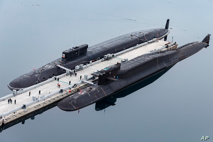 In this handout photo released by Russian Defense Ministry Press Service, Russian nuclear submarines Prince Vladimir, above, and Yekaterinburg are seen at a Russian naval base in Gazhiyevo, Kola Peninsula, April 13, 2021.
