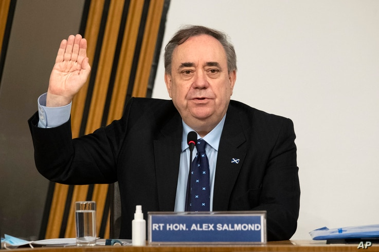 Former Scottish leader Alex Salmond is sworn in before giving evidence to a committee of the Scottish parliament at Holyrood in Edinburgh, Feb. 26, 2021.