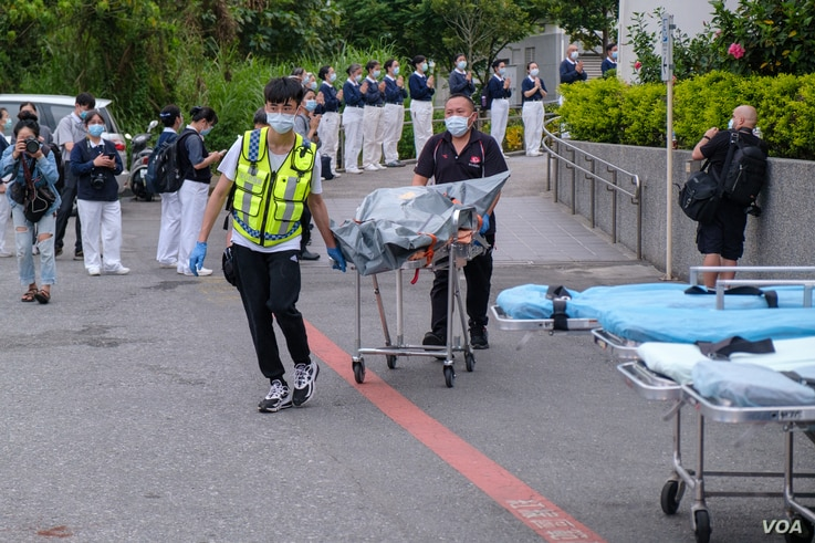 HUALIEN, TAIWAN - APRIL 2: A group of first aids seen carrying a human remains pouch out of a special train. The victim was in a passenger train carrying 490 derails, with at least 48 dead and dozens injured. Taipei on April 7, 2021, Walid Berrazeg