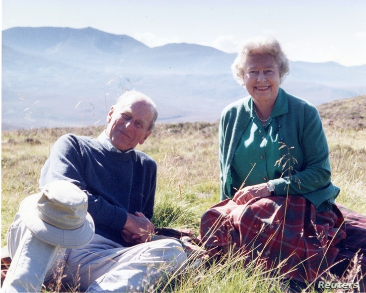 Handout image released by Buckingham Palace of a personal photograph of the Britain's Queen Elizabeth II and Prince Philip, at the top of the Coyles of Muick, taken by the Countess of Wessex in 2003 and obtained by Reuters April 16, 2021.