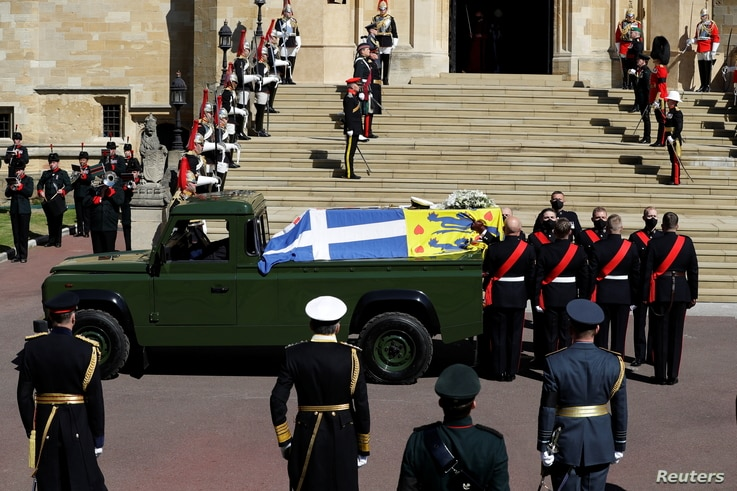 A hearse, a specially modified Land Rover, carrying the coffin of Britain's Prince Philip, is seen on the grounds of Windsor Castle, in Windsor, Britain, April 17, 2021.
