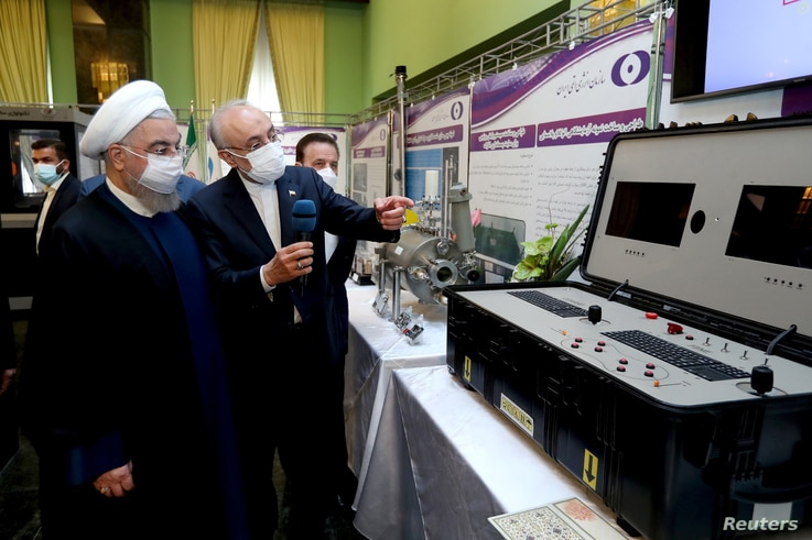 Iranian President Hassan Rouhani reviews his country's new nuclear achievements during Iran's National Nuclear Technology Day, in Tehran, Iran, April 10, 2021. (Iranian Presidency Office/West Asia News Agency/Handout via Reuters)