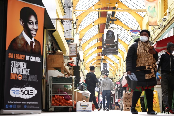 A general view of the exhibition 'Never Forget Stephen Lawrence', comprised of 29 flags installed in Brixton Village ahead of National Stephen Lawrence Day,  in London, April 21, 2021.