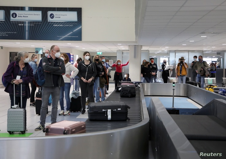 Dutch tourists, who will spend a week long holiday in isolation in their tourist resort as part of an experiment, arrive at the Rhodes International Airport, Greece, amid the COVID-19 outbreak, April 12, 2021.