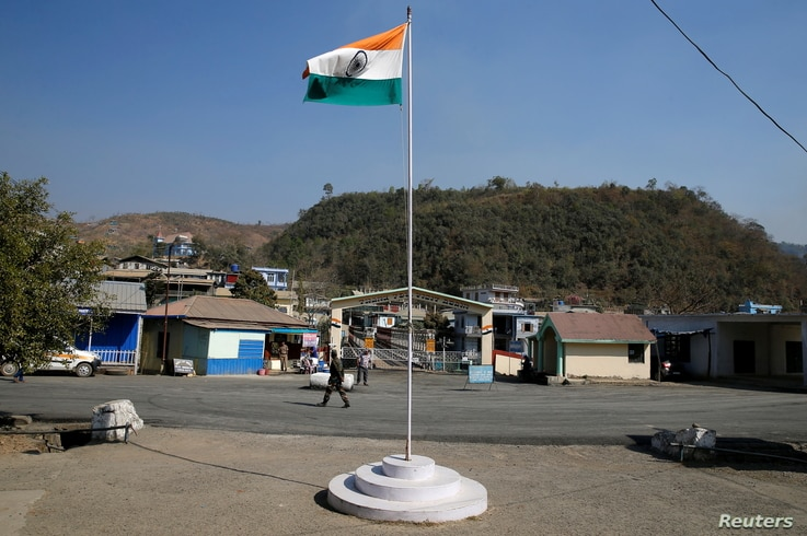 An Indian national flag flies next to an immigration check post on the India-Myanmar border in Zokhawthar village in Champhai district of India's northeastern state of Mizoram, March 16, 2021.