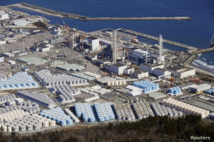 An aerial view shows the storage tanks for treated water at the tsunami-crippled Fukushima Daiichi nuclear power plant in Okuma town, Fukushima prefecture, Japan, Feb. 13, 2021, in this photo taken by Kyodo.