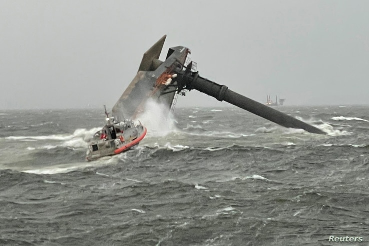 A Coast Guard Station Grand Isle boatcrew heads toward a capsized 175-foot commerical lift boat while searching for people in the water 8 miles (about 13 km) south of Grand Isle, Louisiana, April 13, 2021.