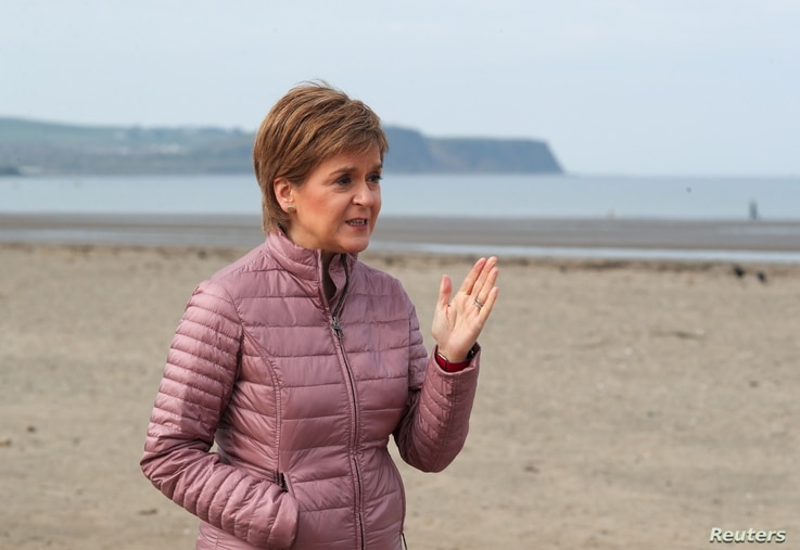 Scottish First Minister and leader of the Scottish National Party (SNP) Nicola Sturgeon speaks as she campaigns for the parliamentary elections, in Ayr, April 19, 2021.