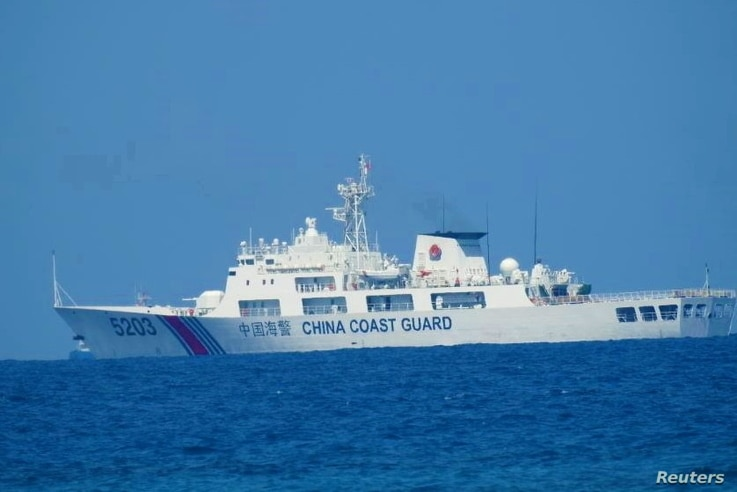 A Chinese Coast Guard patrol ship is seen at South China Sea, in a handout photo distributed by the Philippine Coast guard, April 15, 2021.