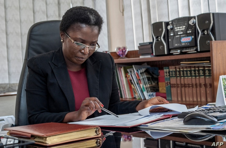 Malawi Ombudsman Martha Chizuma works at her desk before giving an interview with Agence France-Presse in...