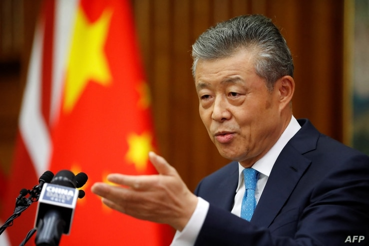 China's ambassador to Britain Liu Xiaoming takes questions from members of the media at the Chinese Embassy in London on...