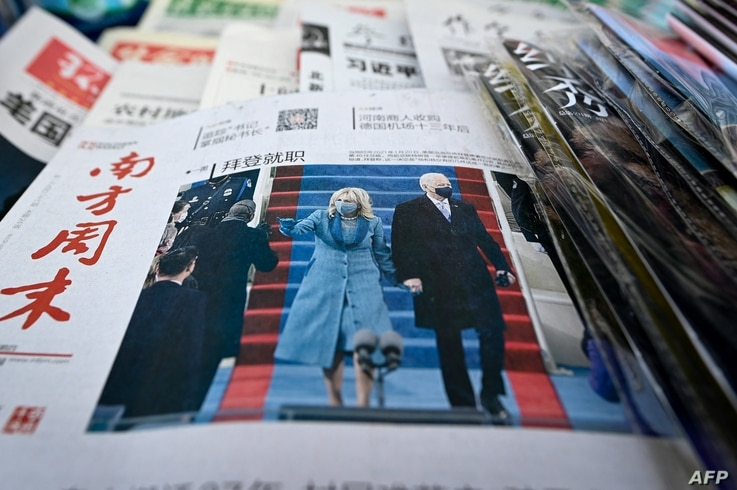 The front page of a Chinese newspapers showing the picture of the inauguration of US President Joe Biden, the 46th US President…
