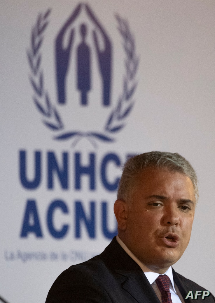 Colombian President Ivan Duque(R) delivers a press conference with UN High Commissioner for Refugees Italian Filippo Grandi …