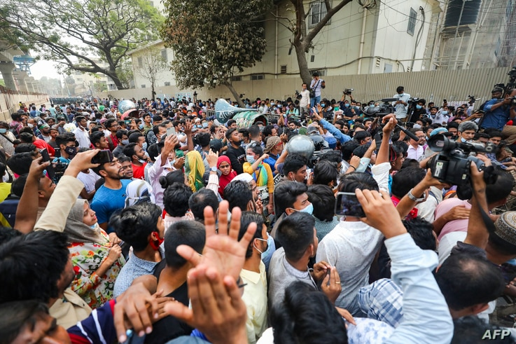Activists shout slogans during a protest against the Digital Security Act (DSA), in Dhaka on March 3, 2021, following the death...
