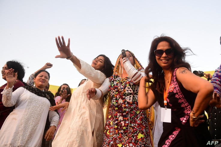 Activists of the Aurat March celebrate as they gather during a rally to mark International Women's Day in Karachi on March 8,…