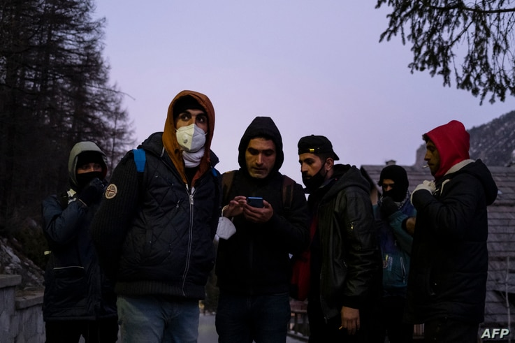 Kurdish migrants gather to organize their attempt to cross the French border in Claviere, Susa Valley, Alps Region, north…