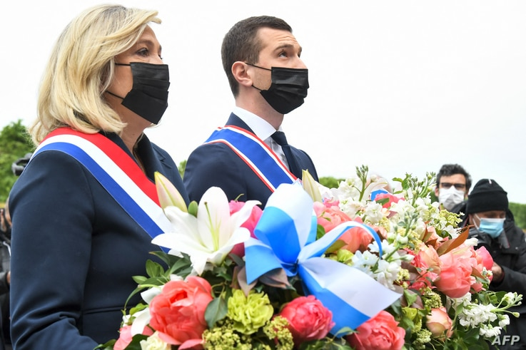 French far-right Rassemblement National (RN) party president Marine Le Pen (L) and French far-right party Rassemblement…