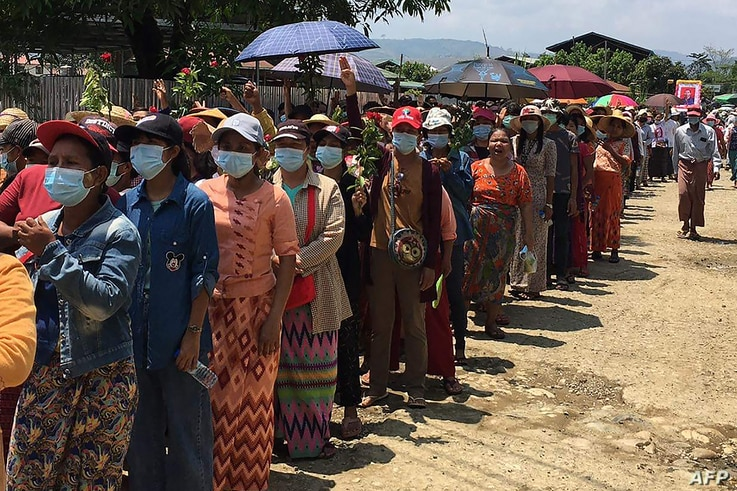 This handout from Kachinwaves taken and released on May 5, 2021 shows people attending the funeral of Wai Phyo, also known as...