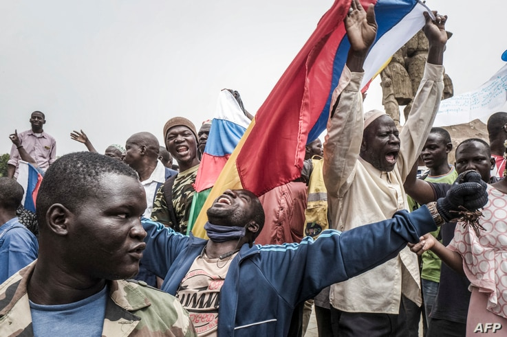 Russians and Malian flags are waved by protesters in Bamako, during a demonstration against French influence in the country on…