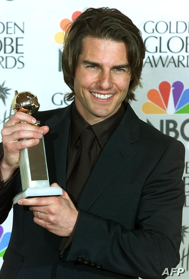 Actor Tom Cruise holds his Golden Globe award for Best Performance by an Actor in a Supporting Role in a Motion Picture Drama…