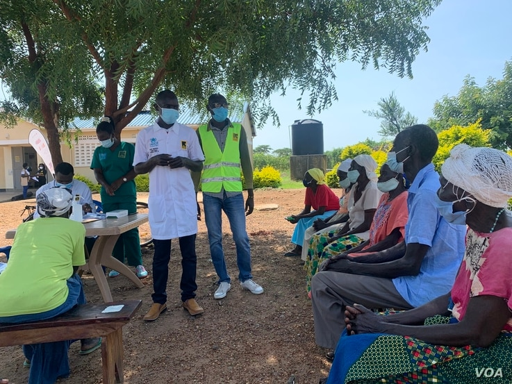 05182021 Photo by Halima Athumani. South Sudanese elders being given counselling at Swinga Health Centre 111, Yumbe district, Northern Uganda, before getting the Covid-19 vaccine..jpg