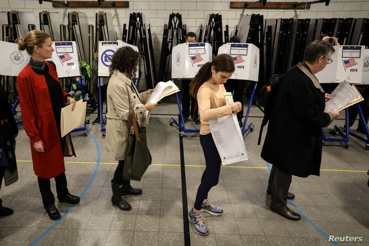 Voters wait in line to vote during the midterm election in the Brooklyn borough of New York City, November 6, 2018.